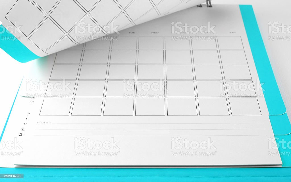 blank blue desk calendar with lines for notes stock photo