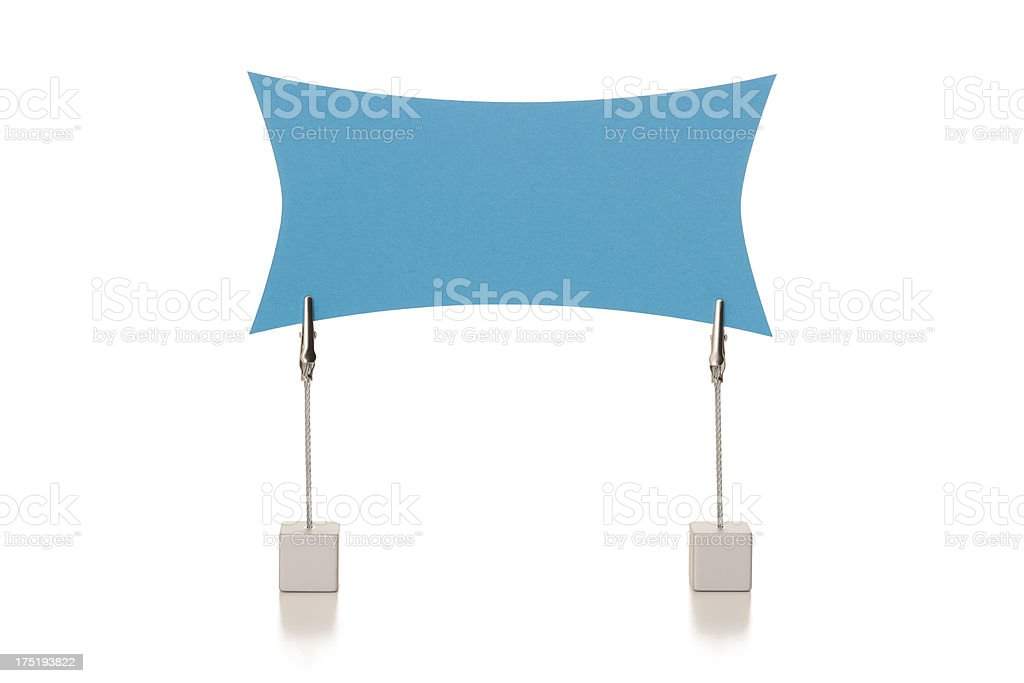 Blank blue sign held in wire clamps royalty-free stock photo