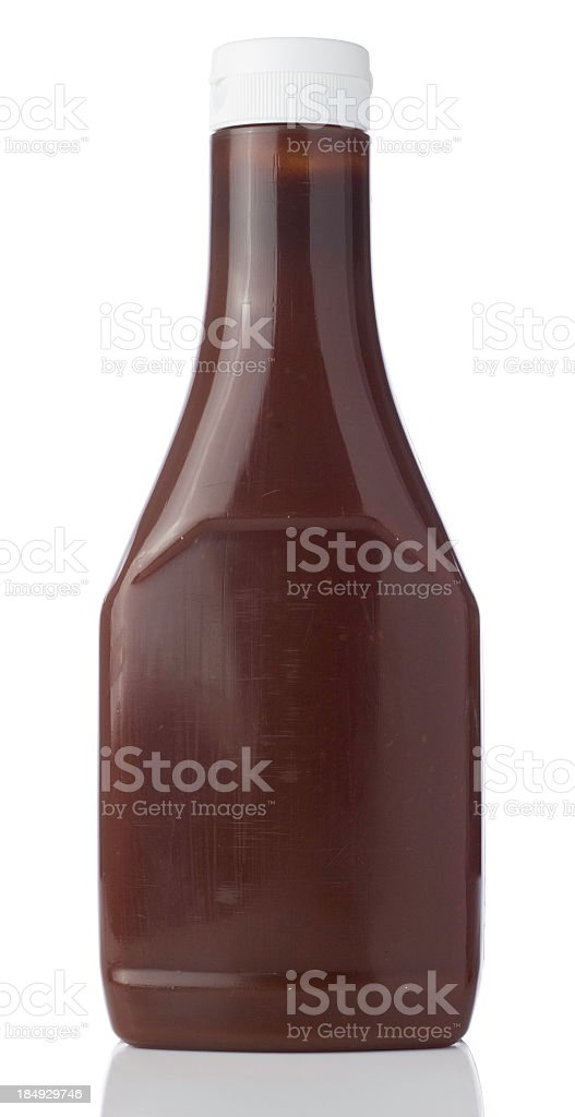 Blank bottle containing a brown liquid with a squirt top lid stock photo
