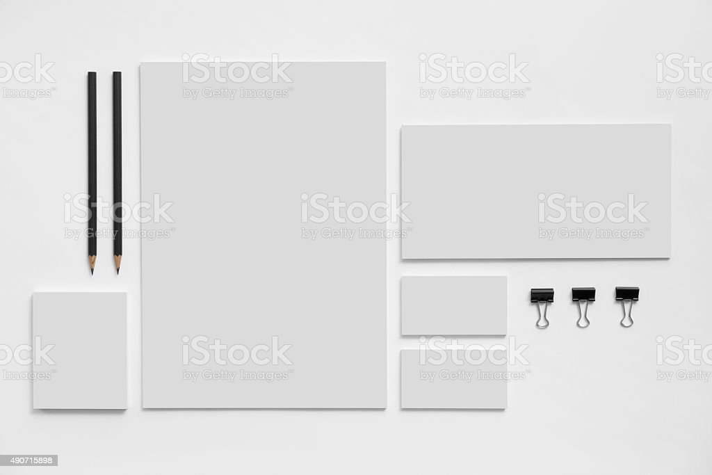 Blank branding mockup with gray business cards on white stock photo