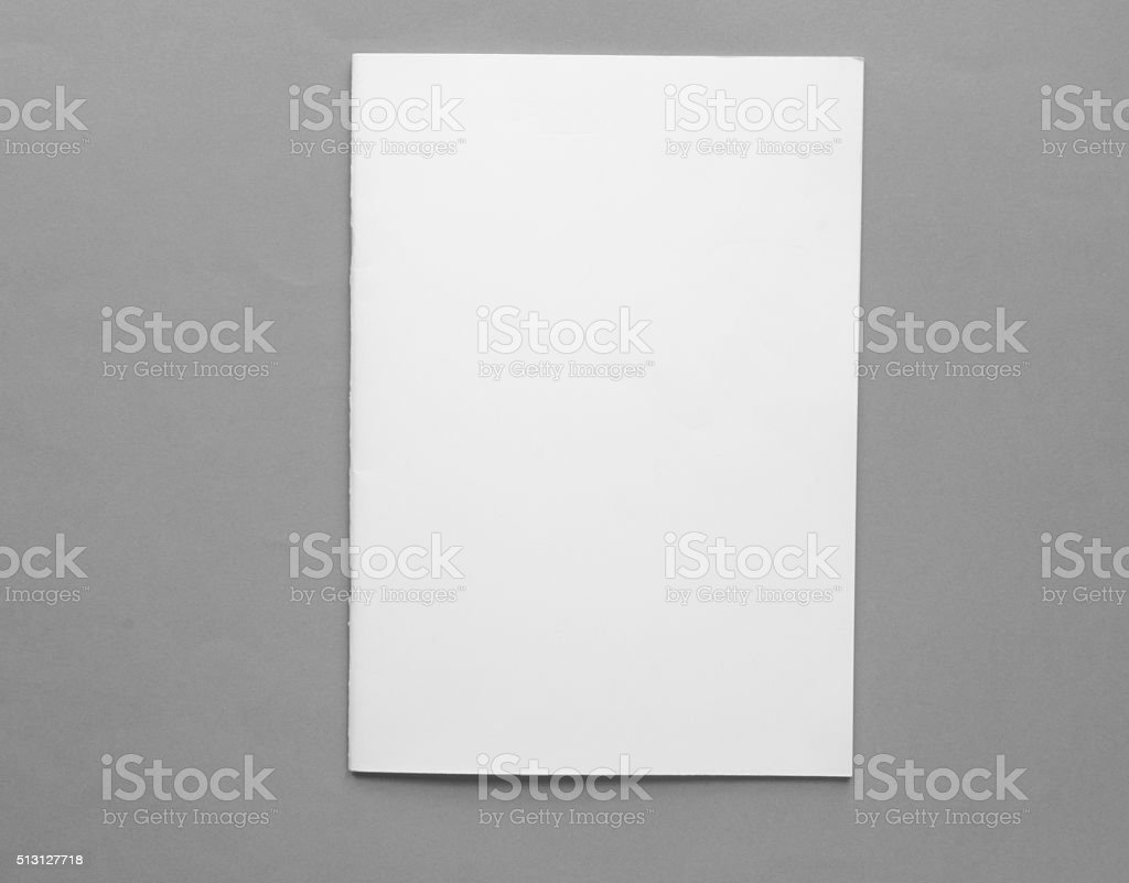 Blank brochure from above in front of grey background stock photo