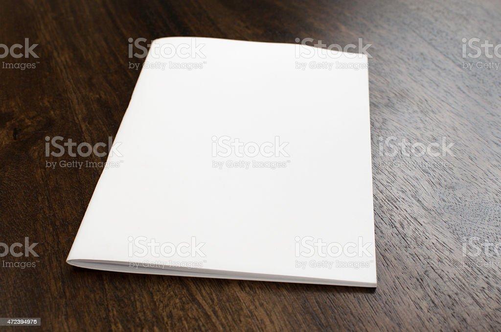 Blank brochure isolated on wood stock photo
