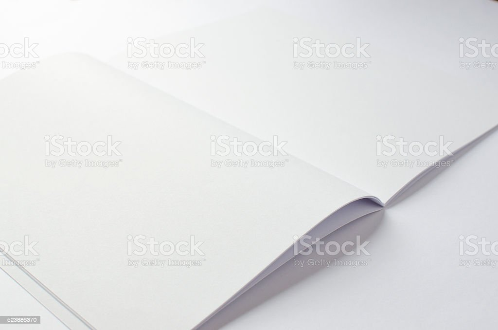 Blank brochure on white with copy space stock photo