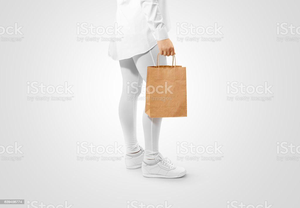 Blank brown craft paper bag design mockup holding hand stock photo