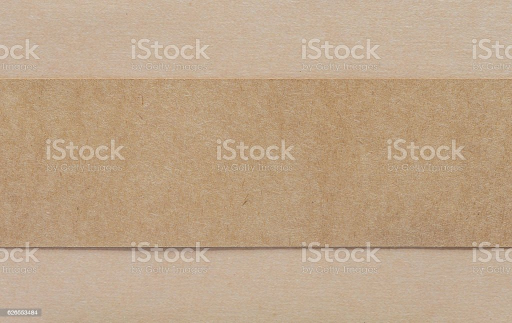 Blank brown paper on brown cardboad background stock photo