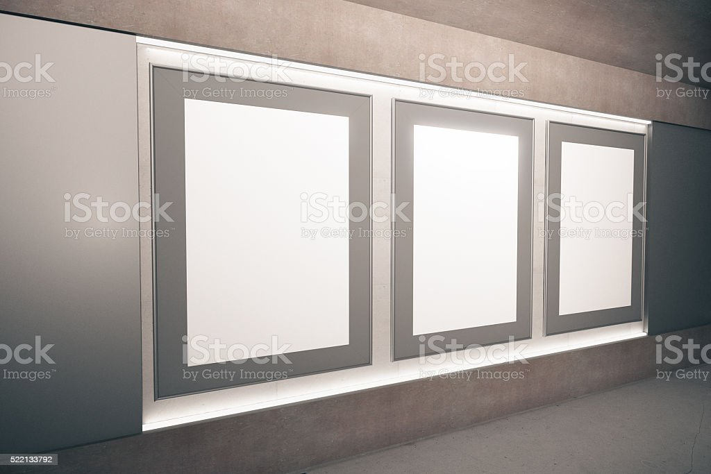 Blank Brown Picture Frames On The Wall In Empty Hall stock photo ...