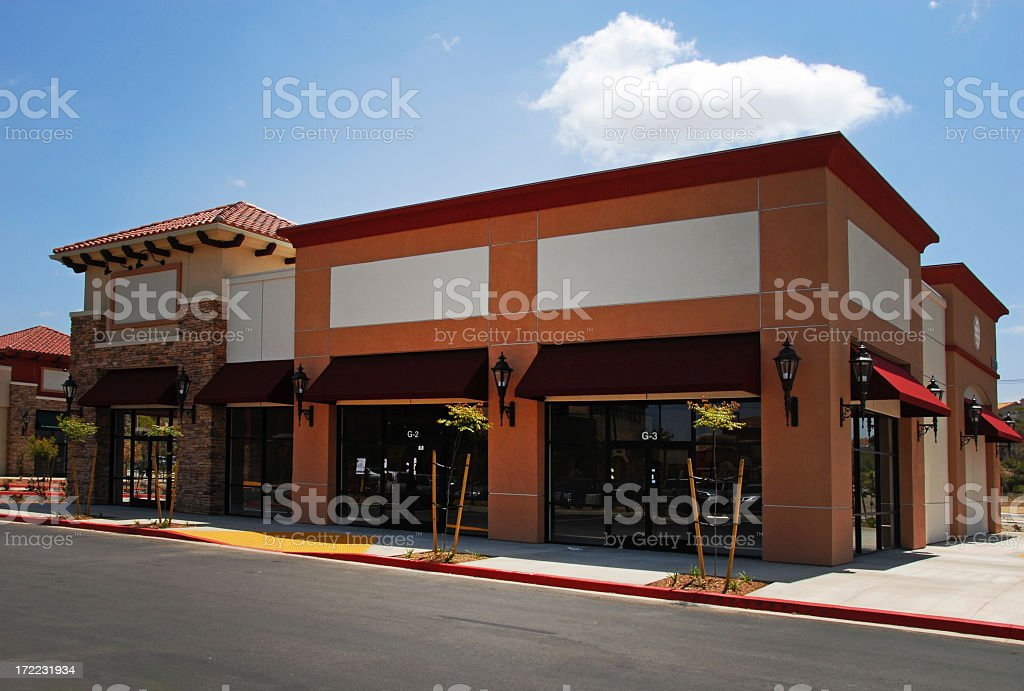 Blank building storefront with awnings stock photo