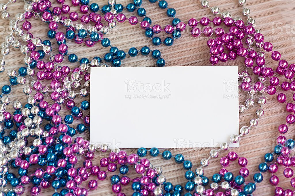 Blank business card and Christmas shiny beads stock photo