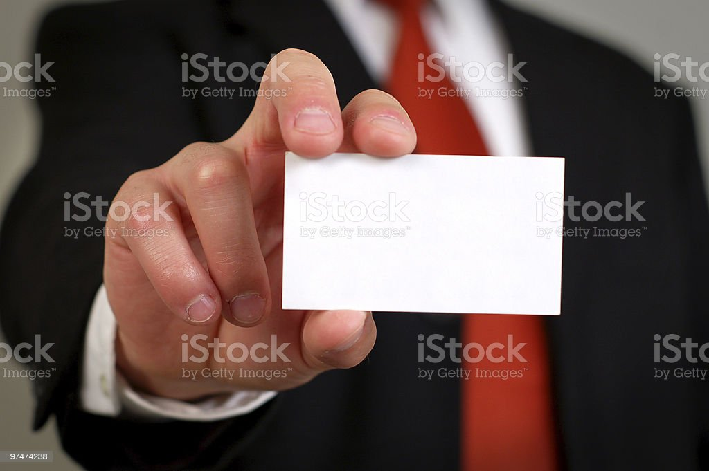 A blank business card being held in plain view of the camera royalty-free stock photo