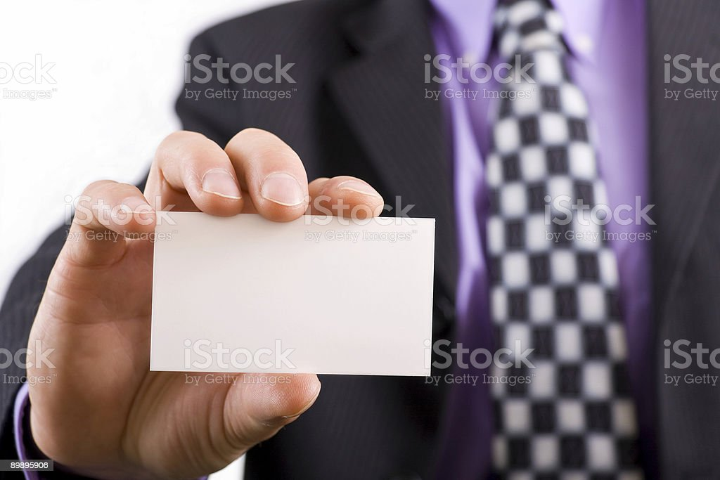 Blank business card in a mans hand royalty-free stock photo