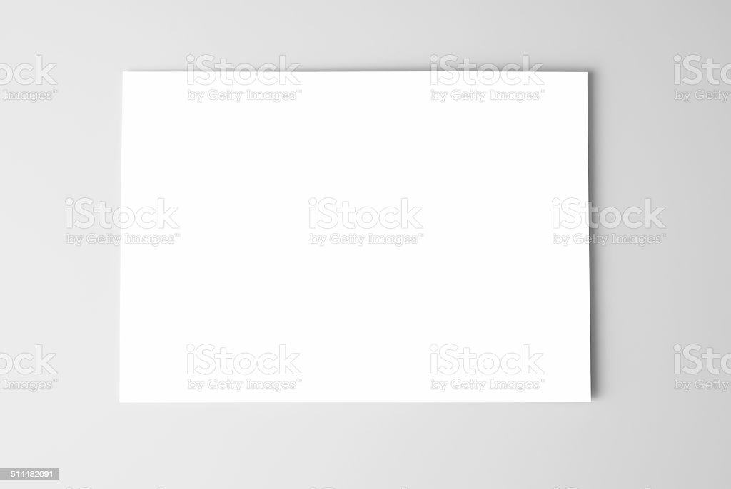 Blank business card or sheet of paper stock photo