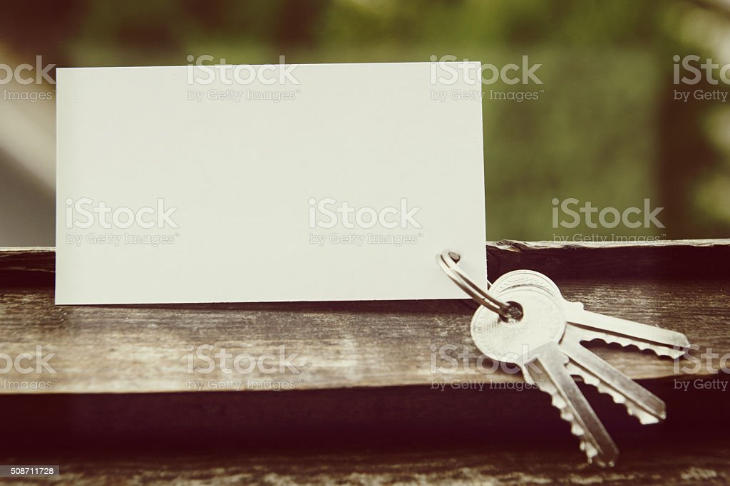 Blank business card with house figure. Real Estate Concept. Top stock photo