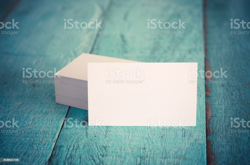 Blank business cards on blue wooden table. stock photo
