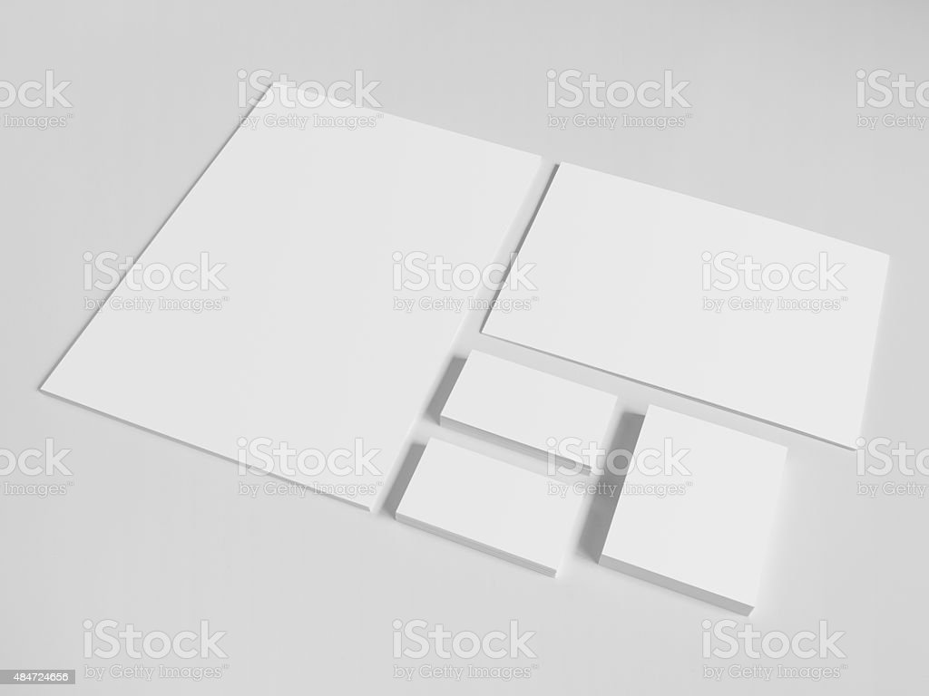 Blank business cards with a pile of papers and envelopes stock photo