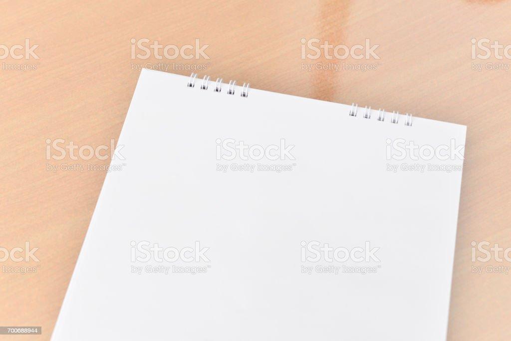 Blank calendar on wood texture. stock photo