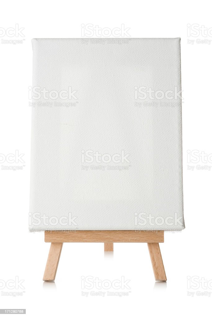 Blank canvas and easel isolated on a white background stock photo