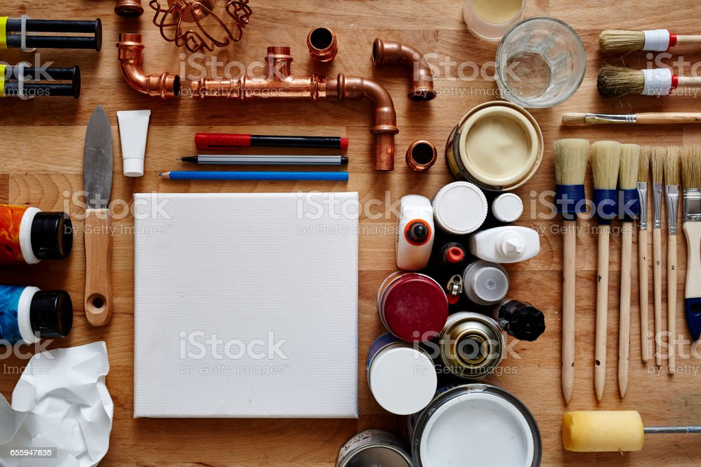 blank canvas in creative chaos stock photo