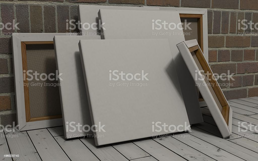 Blank Canvas on exposed brick wall stock photo