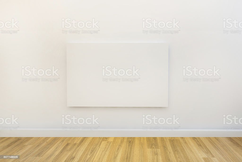 blank canvas on the wall of a studio or gallery stock photo
