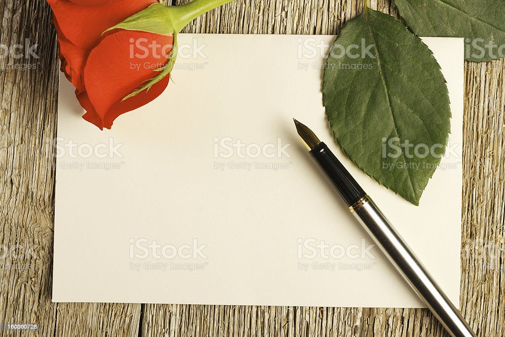 Blank card and a red rose royalty-free stock photo