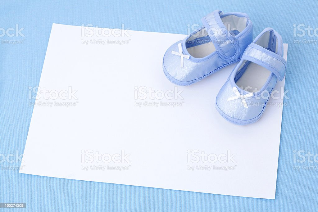Blank card and  Blue Baby Booties stock photo
