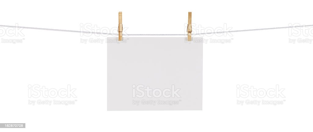 Blank Card Hanging on a Clothesline against White stock photo