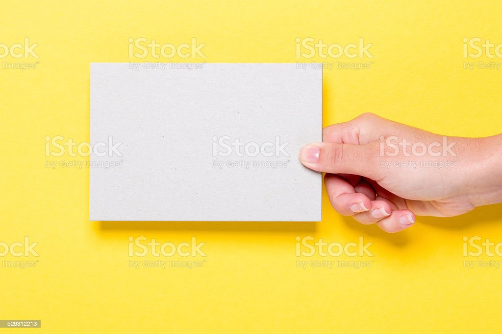 Blank card in a hand XXXL stock photo