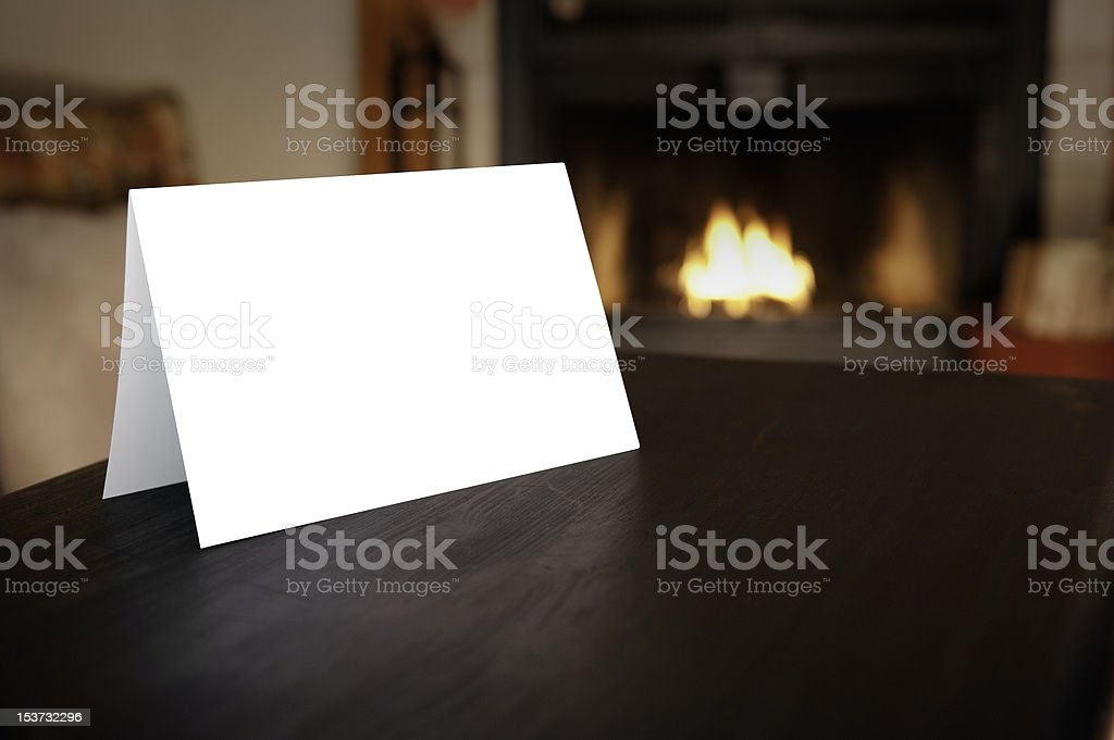 Blank Card in front of Fireplace stock photo