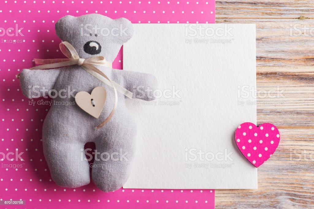 Blank card on pink background with teddy bear stock photo
