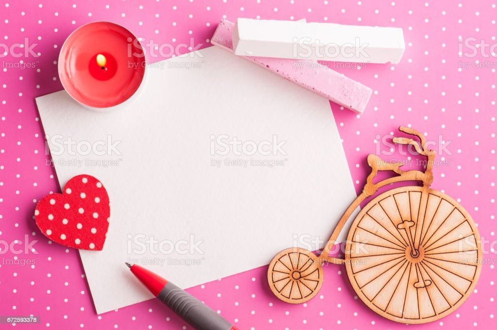 Blank card on pink polka dot background with bike stock photo