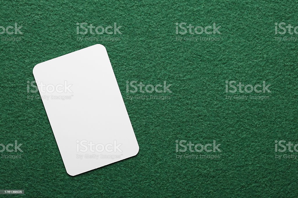 Blank card on the poker table stock photo