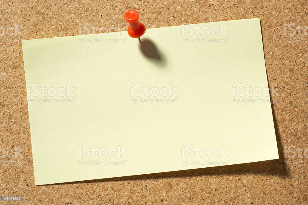 A blank card pinned to bulletin board for leaving a message stock photo