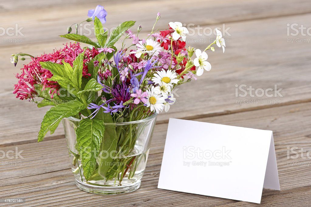 Blank card with bunch of flowers stock photo