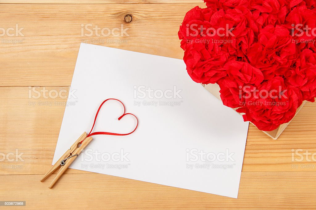 blank card with heart on wooden background stock photo