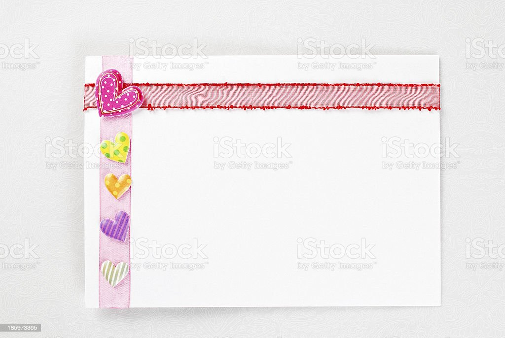 Blank card with hearts and ribbon decoration royalty-free stock photo