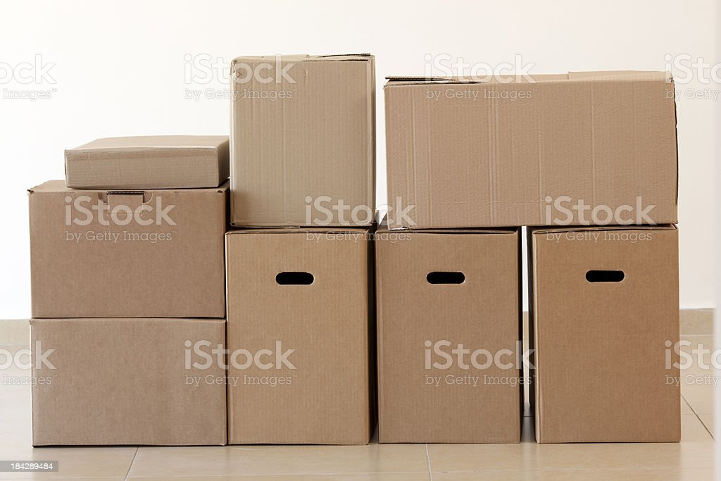 Blank cardboard boxes stacked on top of each other royalty-free stock photo