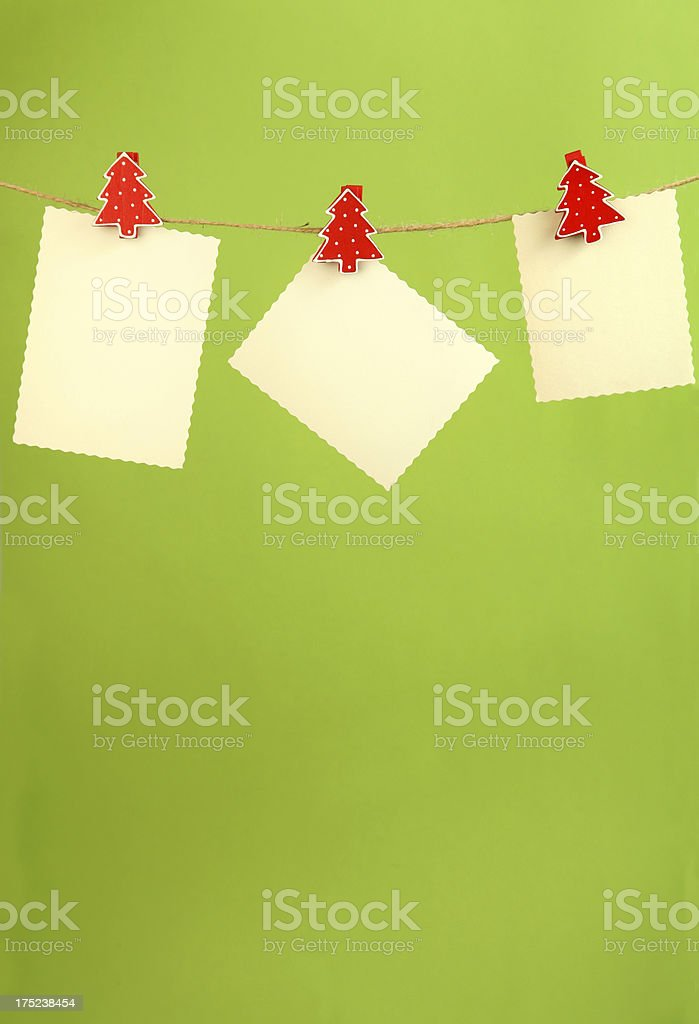 Blank cardboard hanging on clothesline with fir tree peg royalty-free stock photo