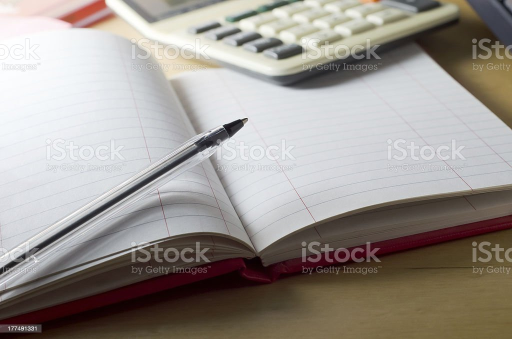 Blank Cash Book and Calculator royalty-free stock photo