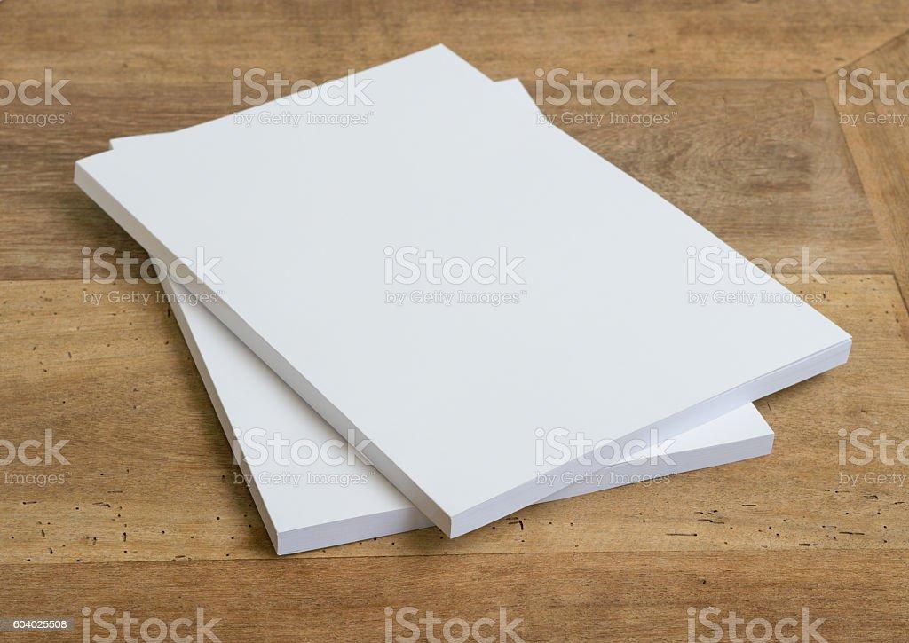 Blank catalog, magazines,book on wood background stock photo