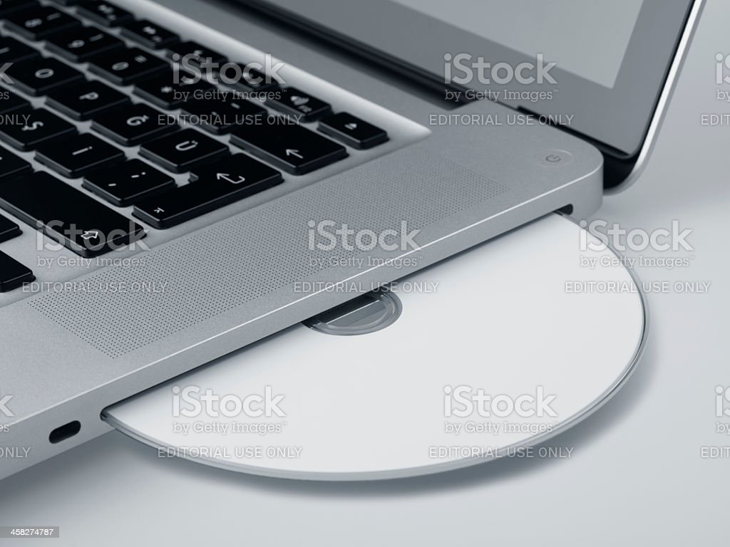 Blank Cd Shown In The MacBook Pro Computer royalty-free stock photo