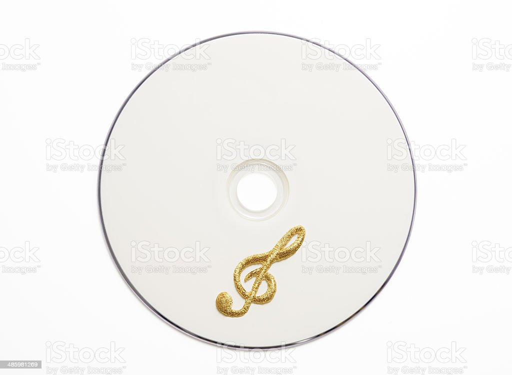 Blank CD with gold embroidery musical note on white background royalty-free stock photo