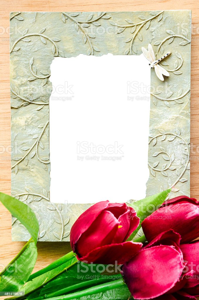 Blank ceramic photo frame and red tulip flower. stock photo