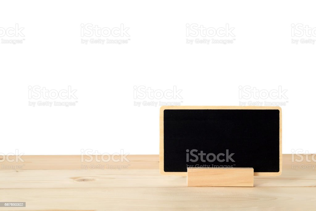Blank chalkboard standing on wood table isolated on white background, space for text, mock up, product display montage, banner stock photo