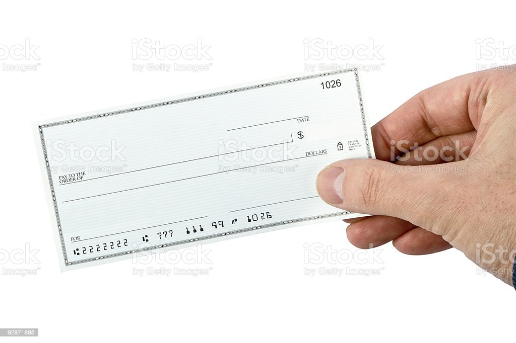 Blank check being held stock photo
