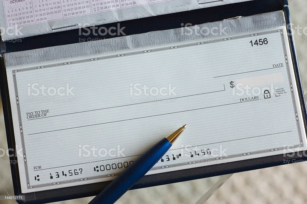 Blank check & pen stock photo