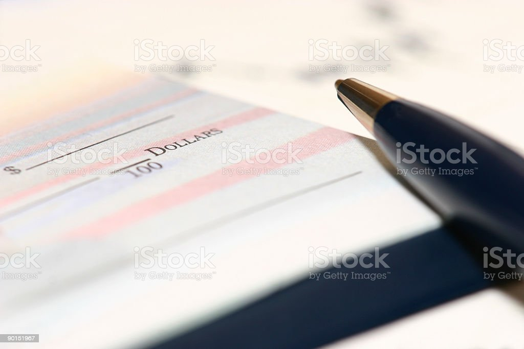 Blank cheque with pen stock photo