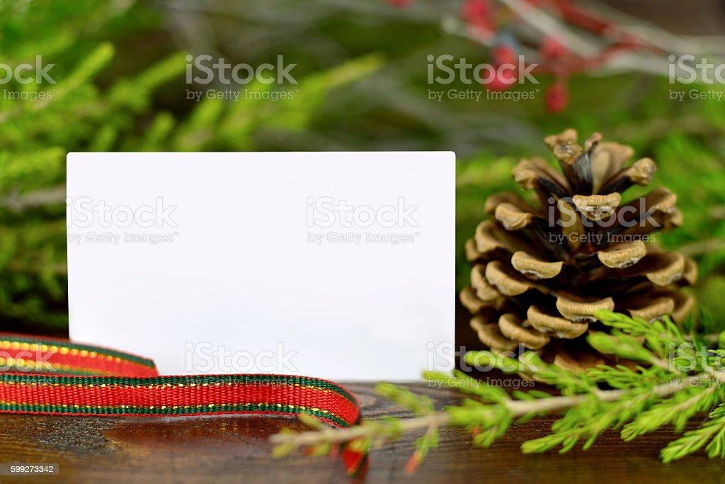 Blank Christmas card and natural Christmas decoration stock photo