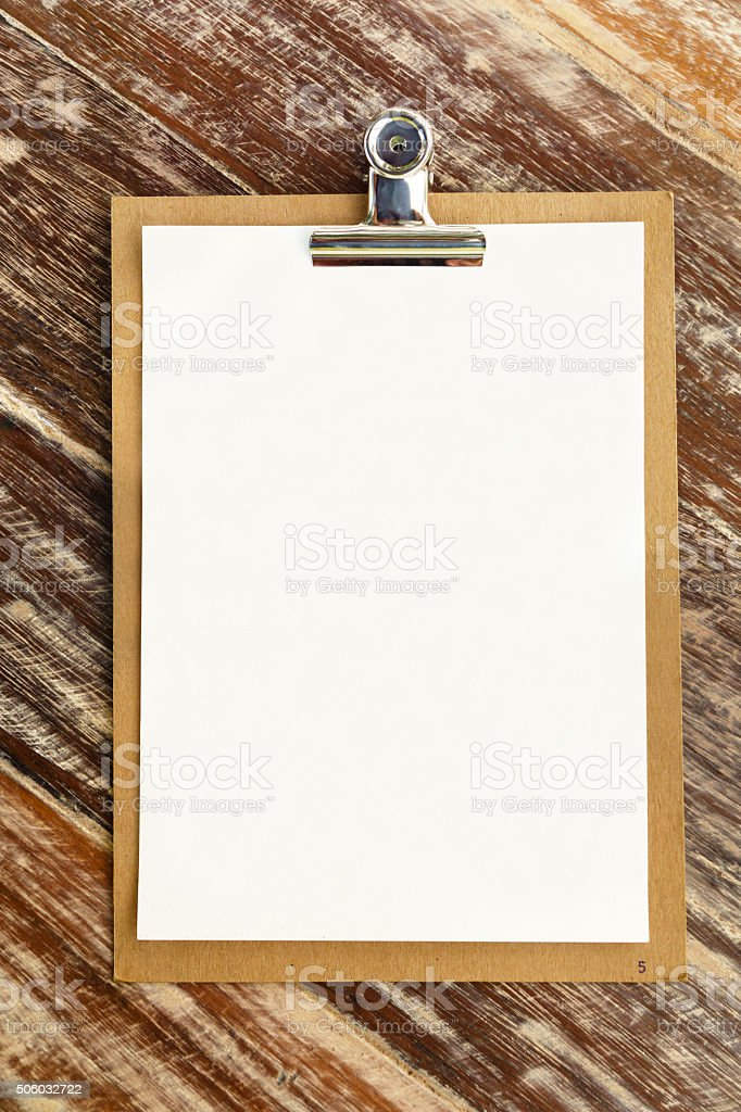 Blank clip on menu on wooden background stock photo