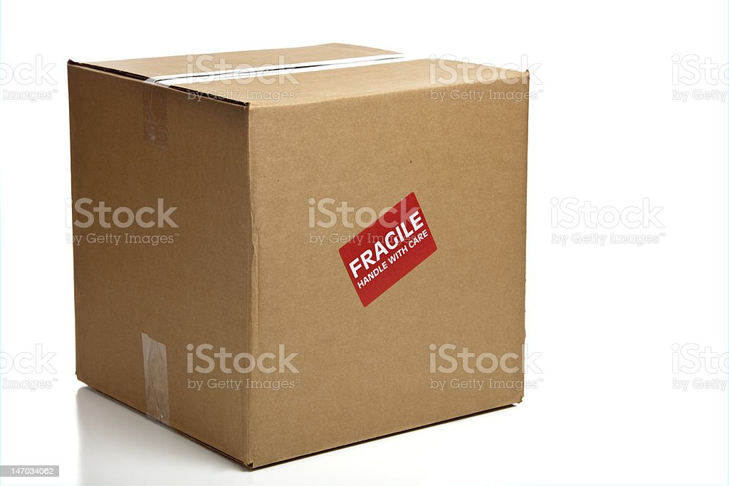 Blank Closed Cardboard Box with a Fragile Sticker royalty-free stock photo