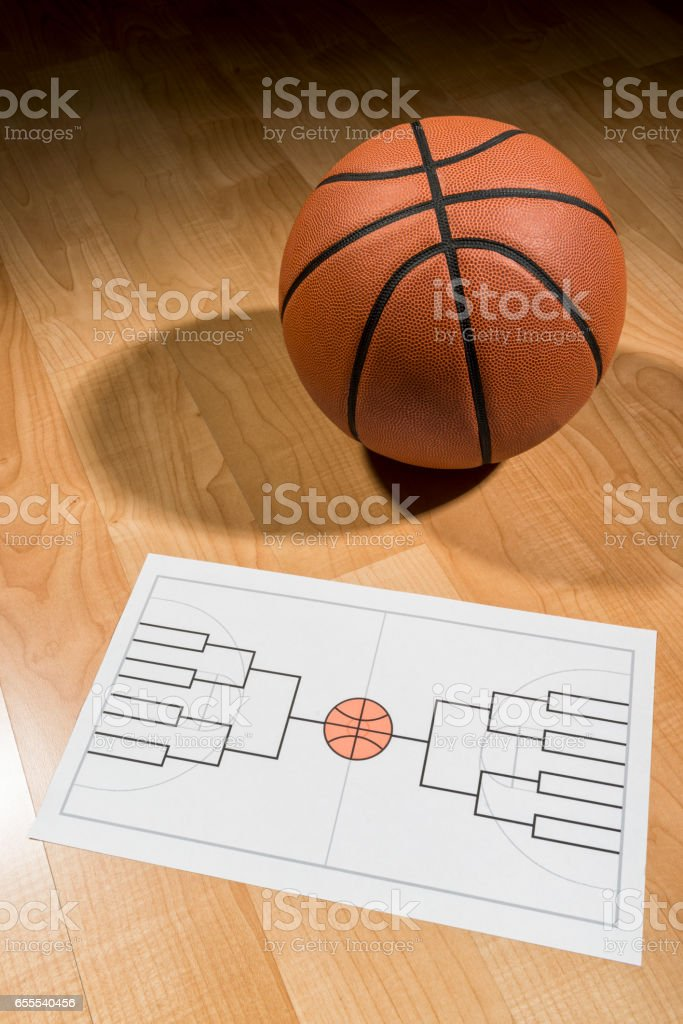 Blank college basketball tournament bracket on paper stock photo
